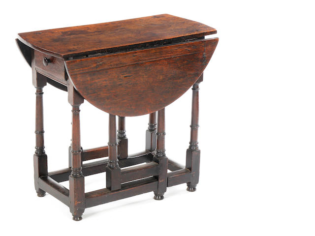 An early 18th century oak gateleg occasional table