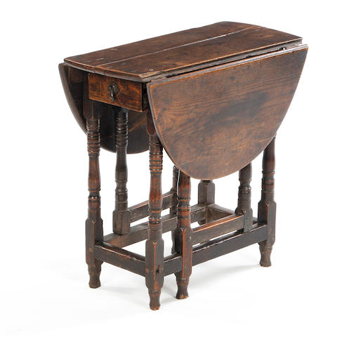 A late 17th century oak gateleg occasional table