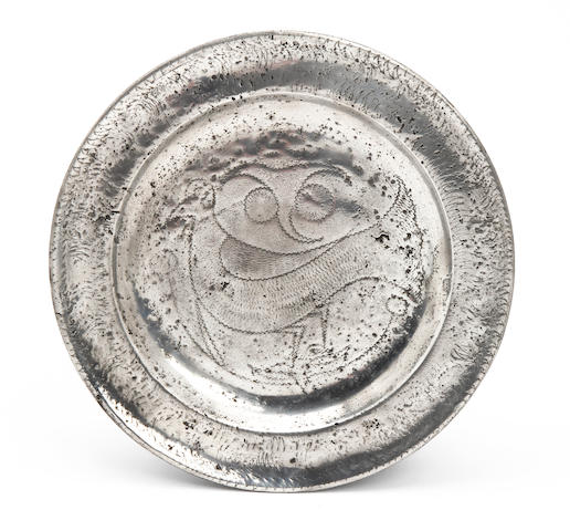 An early 18th century wrigglework plate, circa 1710
