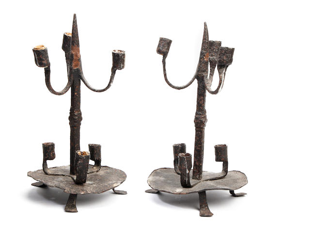 A pair of wrought iron multi-light candlesticksProbably late 17th Century, Dutch or German