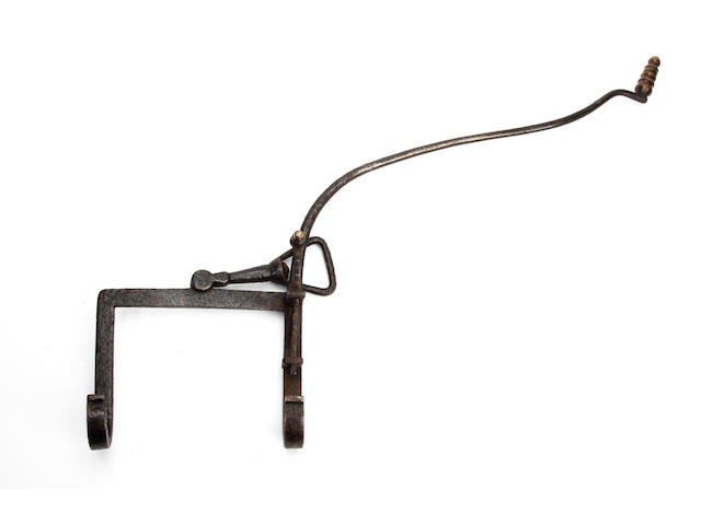 An 18th Century iron pivoting kettle tilter