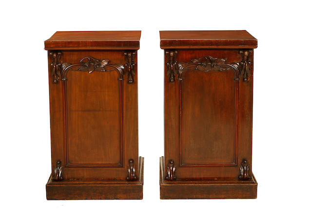 A pair of early Victorian mahogany pedestal cabinets