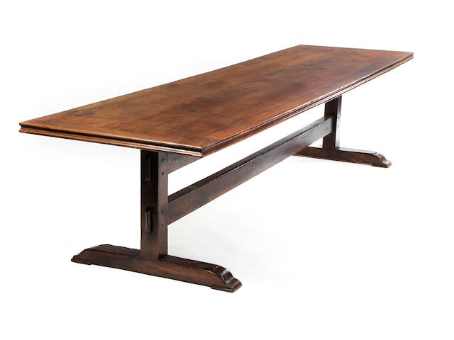 An early 20th century large oak trestle-base table Circa 1900