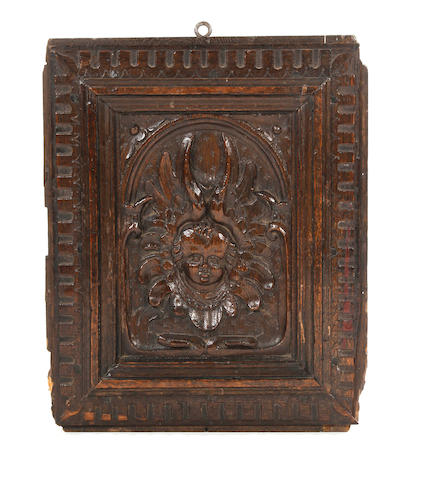 A 17th Century carved oak door panel, North European