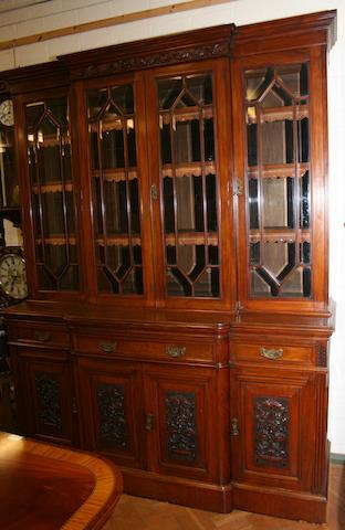 A late Victorian walnut breakfront library bookcase