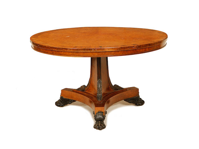 A Regency amboyna and rosewood crossbanded breakfast table