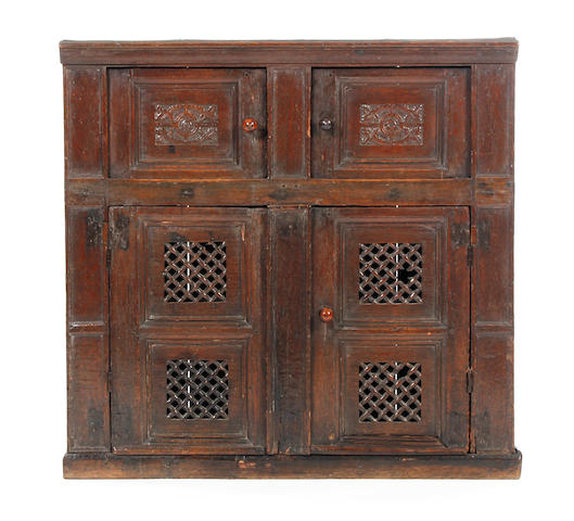 An unusual oak food cupboard Early 17th century