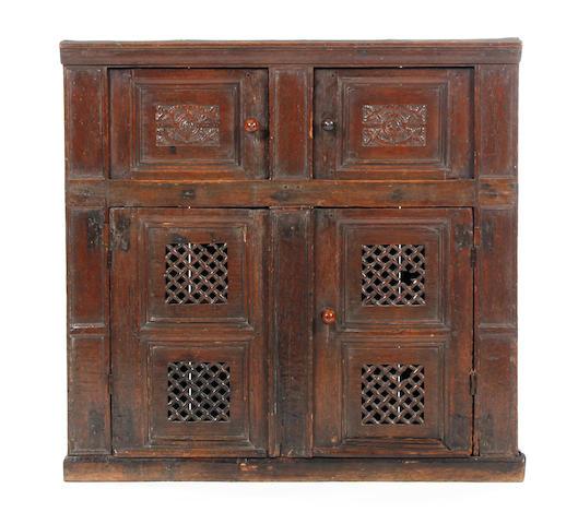An unusual oak food cupboard Early 17th century