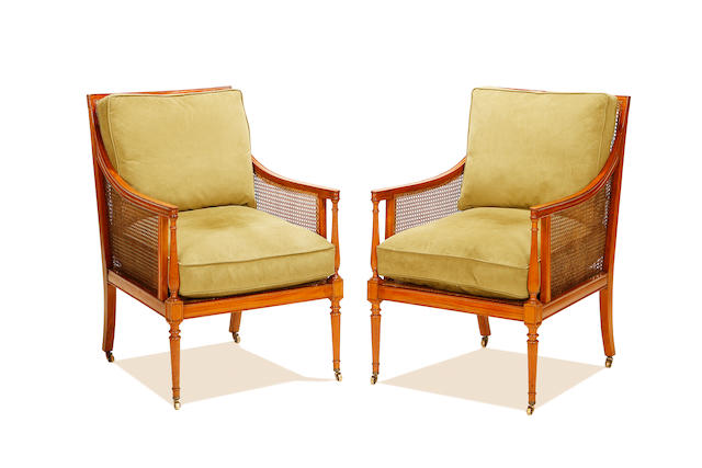 A pair of late Victorian satinwood caned bergeres by Gill & Reigate