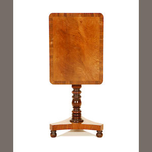 A Regency mahogany and crossbanded rectangular pedestal table