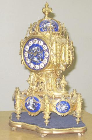 A French late 19th Century gilt metal Medieval Revival mantel clock T A Simpson & Co
