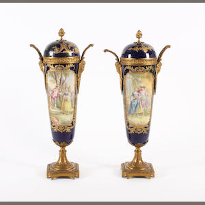 A pair of Sevres slender tapering vases and covers