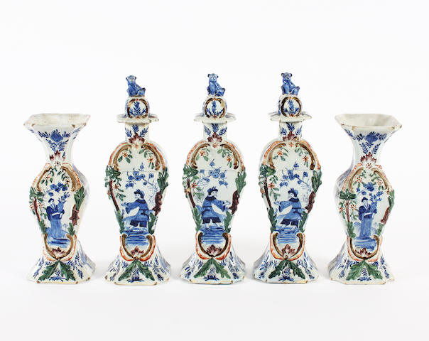 A Dutch Delft garniture of three vases and covers and two beaker vases, 19th century