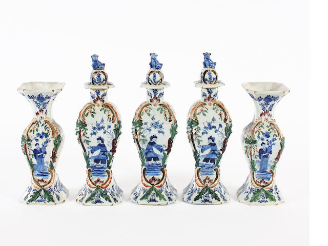 A Dutch Delft garniture of three vases and covers and two vases, 19th century