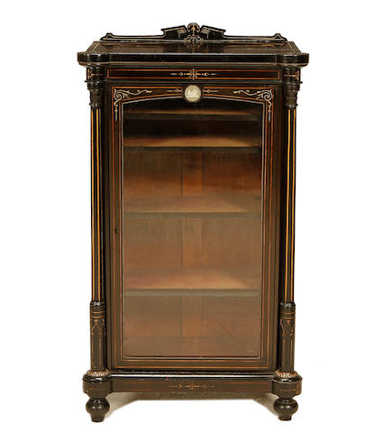 A mid Victorian gilt metal mounted ebonised music cabinet