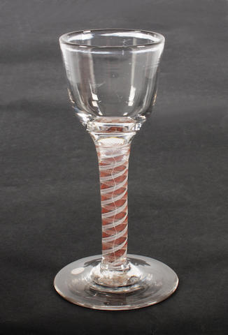 A red colour-twist wine glass