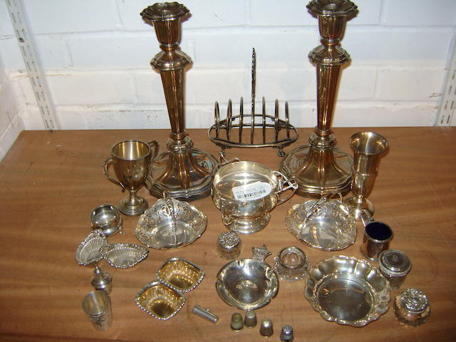 Collective small silver wares,  comprising four bon bon dihses, an Edward VIII ash tray with cyphier and date 1937, various condiments, thimbles,cheroot holder, two handled cup, etc, also a pair of Sheffield plate table candlesticks and an EP toast rack (parcel).