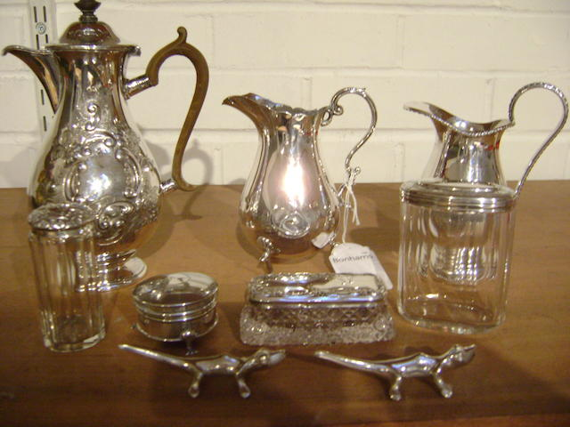 A silver baluster milk jug,  on three feet, 14cm high,three glass toilet jars with silver mounts, a small silver ring box,approx 6 oz's of weighable silver, together with two EP jugs and a pari of lizard knife rests. (parcel).