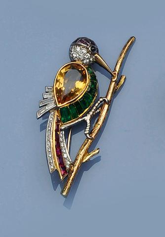 A diamond and vari gem-set bird brooch