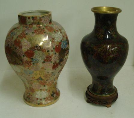 A modern Japanese Kutani inverted octagonal vase, painted with flowers enclosing figure panels, 43cm, signed, and a modern cloisonne baluster vase, 39cm, hard wood stand. (3)