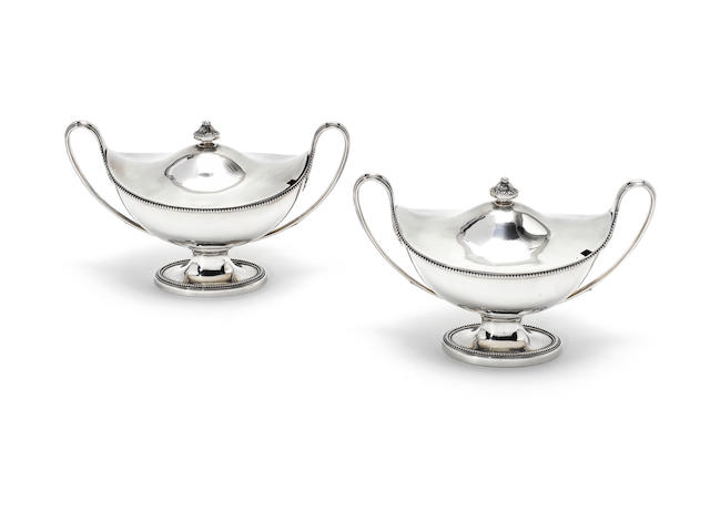 A pair of George III silver sauce tureens and covers, by Fogelberg & Gilbert, London 1783-4,