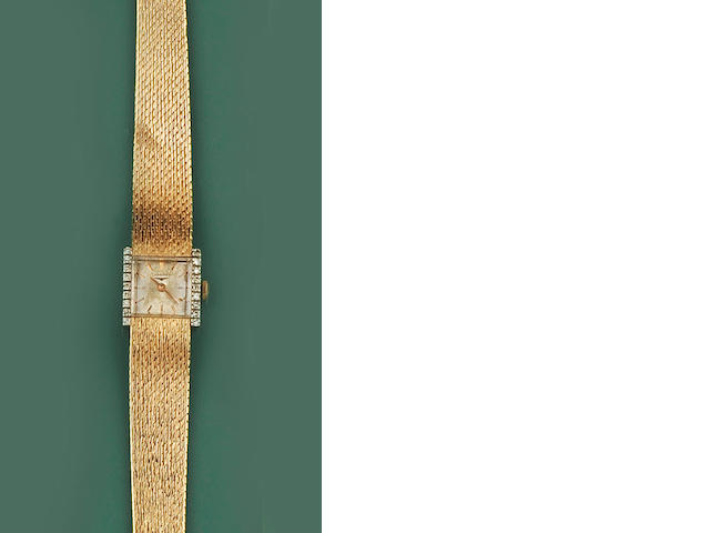 Longines: A diamond set lady's wristwatch