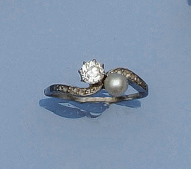 A pearl and diamond dress ring
