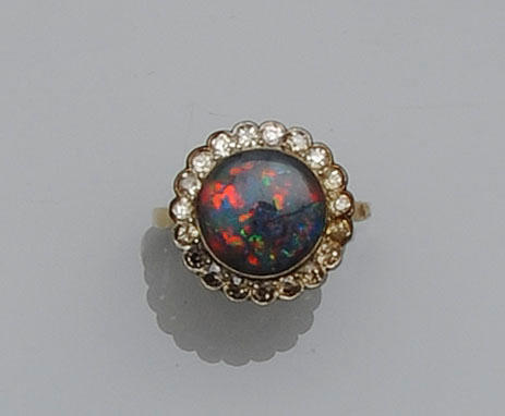 A black opal and diamond cluster ring
