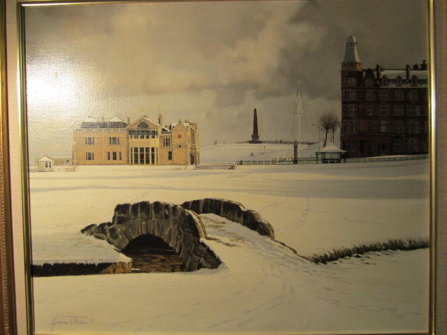 G Baxter: St Andrews in the snow Featuring the Bridge over the Swilken Burn, the 18th fairway, the R & A Club House, The Martyrs Memorial and the red bricked Hamilton Hall. Oil on canvas, signed and dated (90) lower left, framed.