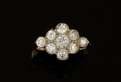 A diamond set nine stone ring