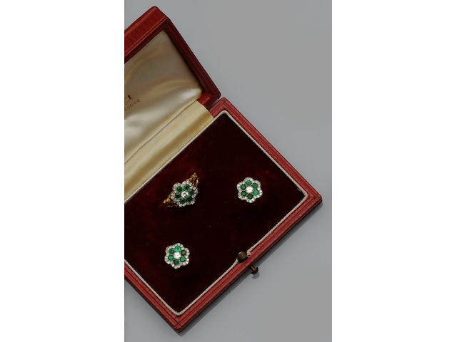 An emerald and diamond ring and earstud cluster suite