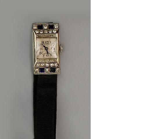 An 18ct white gold diamond and sapphire cocktail watch