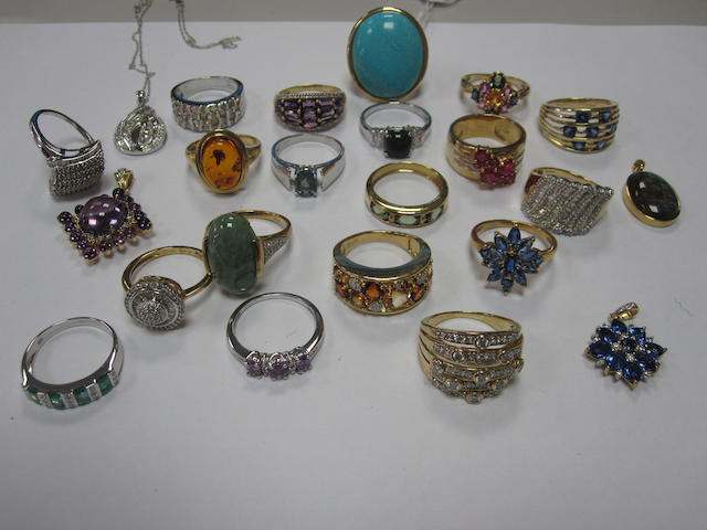 A collection of 19 assorted gem set rings and four gem set pendants, (23)