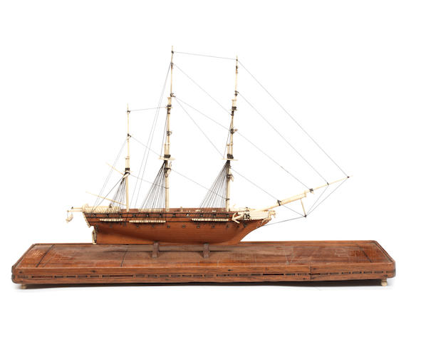 A 19th century bone and fruitwood model of a three masted ship Diligente. 20x6x13ins. (51x15x33cm)