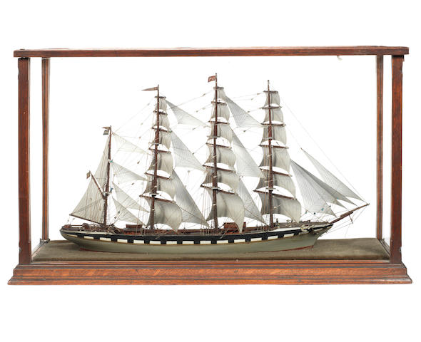 A cased waterline model of a four masted Barque. 25x15x8ins. (63.5x38x20cm)