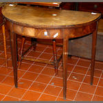 A George III mahogany 'D' shaped card table