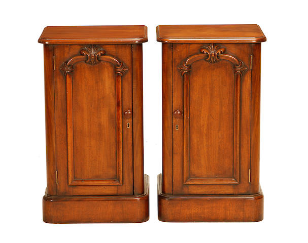 A pair of mahogany bedside cupboards in the Victorian style