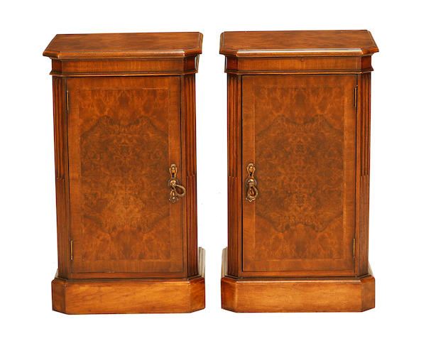 A pair of walnut bedside cupboards