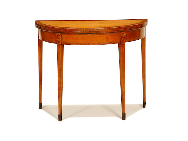 A late George III satinwood and rosewood crossbanded demi lune card table