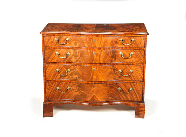 A George III figured mahogany and crossbanded serpentine chest