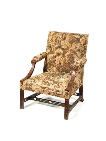 A George III Irish carved mahogany library open armchair