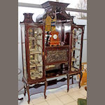 A Maple & Co carved mahogany display cabinet