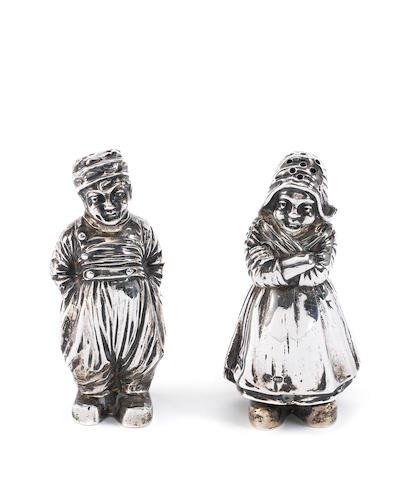 A Continental novelty salt and pepper, import marks for Berthold Muller, London 1911-1913, and three other toys (5)