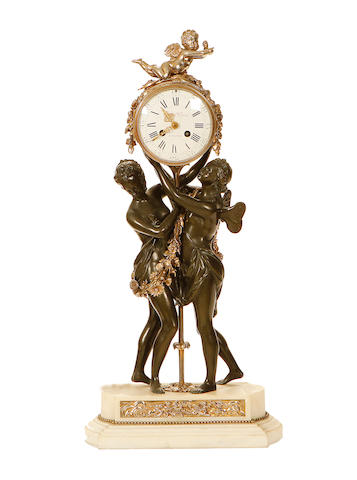 A bronze and silver plated clock