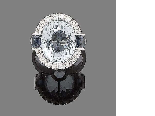An aquamarine, sapphire and diamond cluster ring
