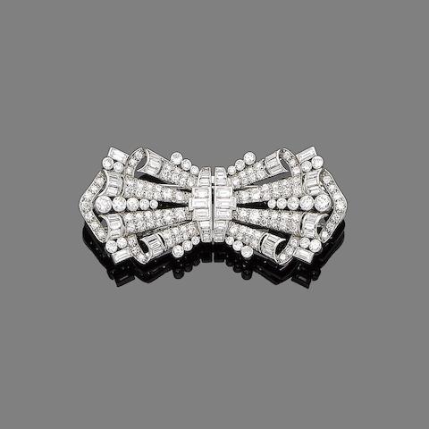A diamond double-clip brooch,
