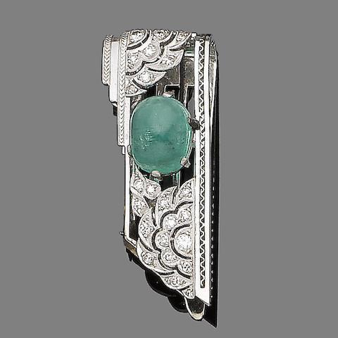 An emerald and diamond clip brooch