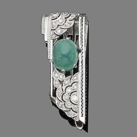 An emerald and diamond clip brooch