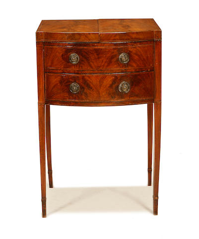 A George III mahogany and rosewood crossbanded gentleman's dressing table