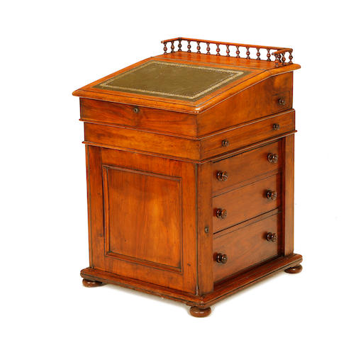 An early Victorian figured walnut davenport